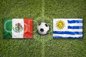 Mexico vs. Uruguay flags on soccer field