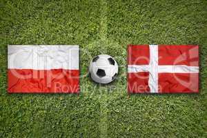 Poland vs. Denmark flags on soccer field
