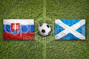 Slovakia vs. Scotland flags on soccer field