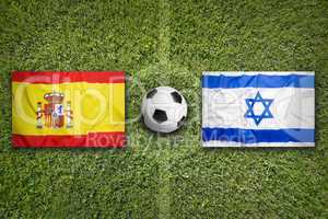Spain vs. Israel flags on soccer field