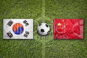 South Korea vs. China flags on soccer field