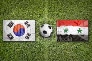 South Korea vs. Syria flags on soccer field