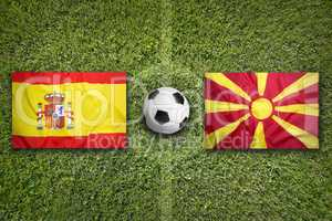 Spain vs. Macedonia flags on soccer field