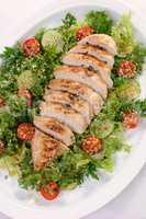 Chicken fillet in a vegetable garnish