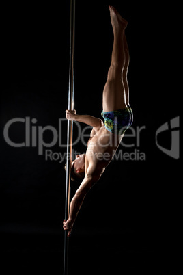 Pole dance. Photo of strong guy posing at camera
