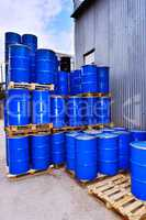 Blue metal fuel tanks of oil stored at the production site