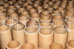 Manufacturing background in the form of cardboard tubes
