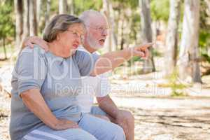 Senior Couple Pointing Exploring The Outdoors