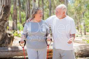 Happy Senior Couple Exercising Outside Together