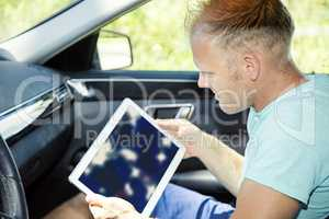 Man with Tablet PC and automotive