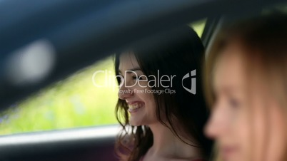 Young female waiting her friend in the car