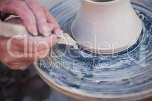 Close-up of potter making pot