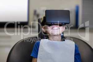 Boy using virtual reality headset during a dental visit