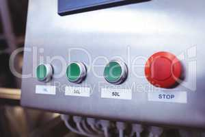 Stop button on machinery at brewery