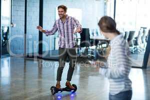 Graphic designer standing on hoverboard