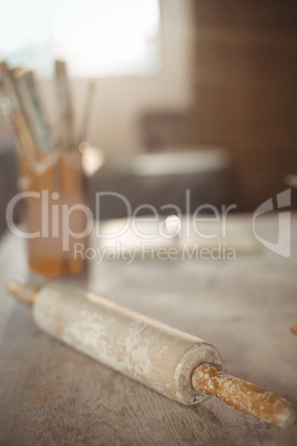 Close-up of rolling pin on table