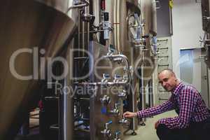 Brewery manufacturer adjusting pressure gauge