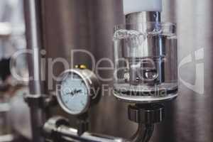 Gauge on storage tank in brewery