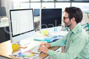 Graphic designer working on computer