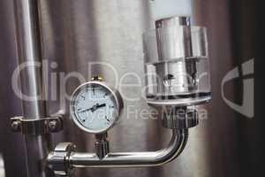 Pressure gauge on storage tank in brewery