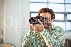 Graphic designer clicking photo from digital camera