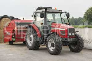 Red tractor with red cattle feed diffuser.