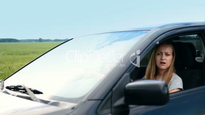 Pretty girls traveling countryside by car