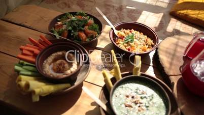 Closeup of vegetarian food on rustic wooden table