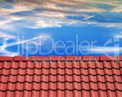 Roof tiles and sunset sky