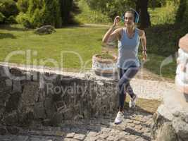 The girl running in the park.