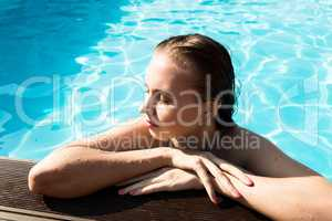 fashion photo of beautiful glamour young woman in bikini posing in summer on the swimming pool having fun and tanned. leisure and recreation concept