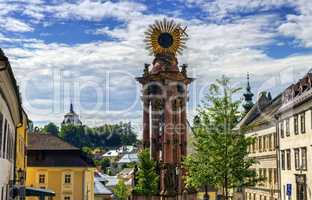 Plague column in the Trinity Square and new castle, Banska Stiavnica, Slovakia