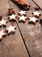 Sweet cinnamon stars on a wooden table