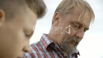 Farmer is watching and talking to a Boy