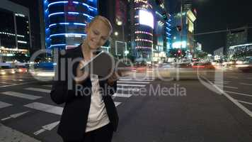 Woman with tablet PC in night Seoul, South Korea