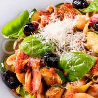 Ribbon Pasta with zucchini and olives in tomato sauce