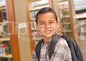 Hispanic Student Boy with Backpack in the Library