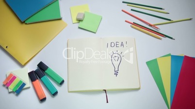 Bright idea concept appearing on white note pad
