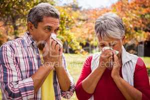 An elderly couple giving a blow