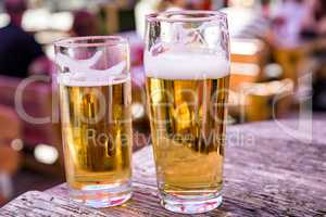 Beer glasses with beer on the table in the beer garden