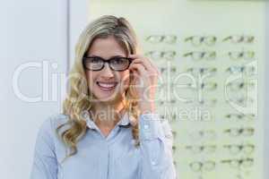 Beautiful female customer holding spectacle