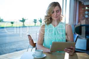 Woman using a digital tablet in the coffee shop