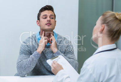 Patient discussing his problem with female patient
