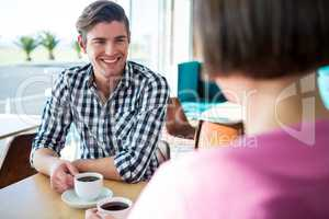 Man talking to a woman in coffee shop
