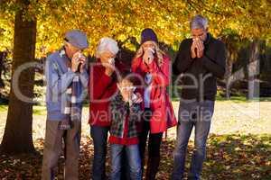 Sick family using tissues