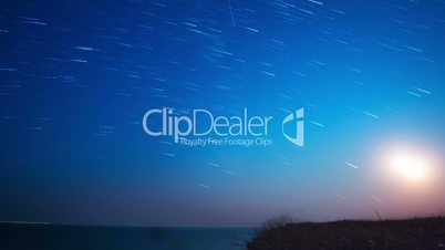 Stars and Moon over the Sea. Time Lapse