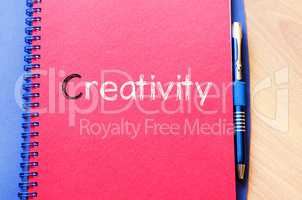 Creativity text concept on notebook