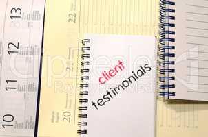 Client testimonials text concept on notebook