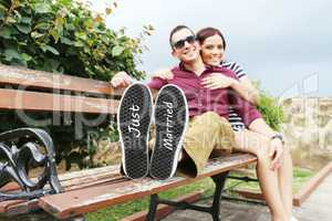 """Young beautiful couple with message """"Just married"""" in his shoes."""