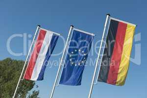Dutch flag, European Union flag and German flag.
